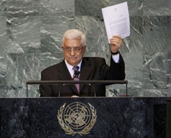780623_palestinian-president-mahmoud-abbas-holds-up-a-copy-of-the-letter-that-he-had-just-delivered-to-united-nations-secretary-general-ban-ki-moon-at-u-n-headquarters-in-new-york